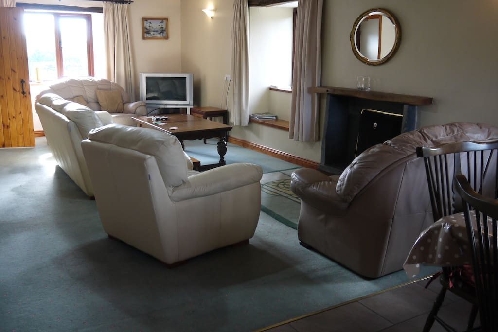 Spacious lounge with comfortable leather seating