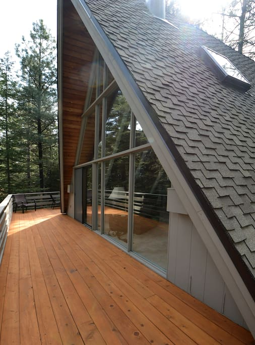 wrap-around deck set amidst the trees and birds