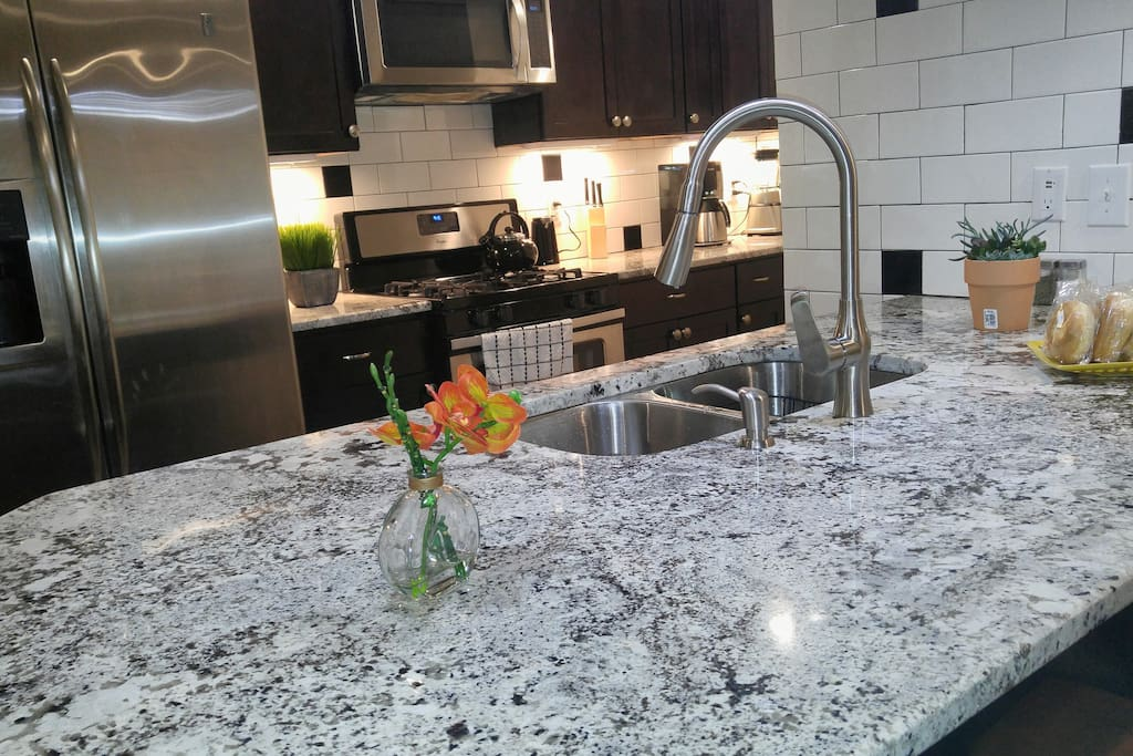 Brazilian Marble counter tops with stainless steel appliances