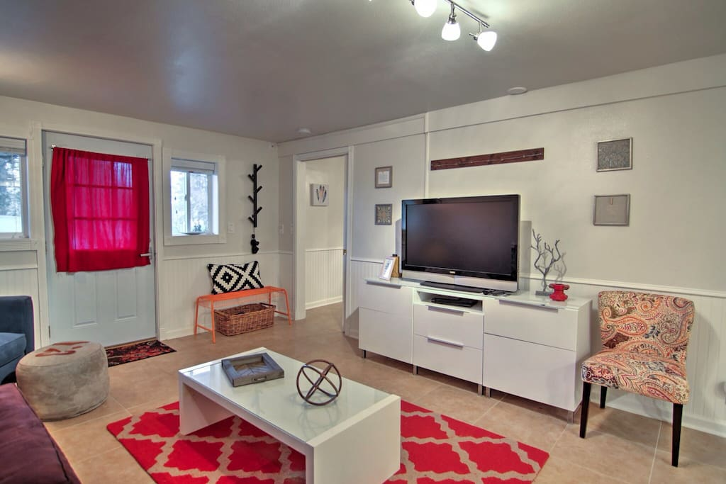Brightly decorated living room adjoins the large bedroom (bedroom door just inside entryway).