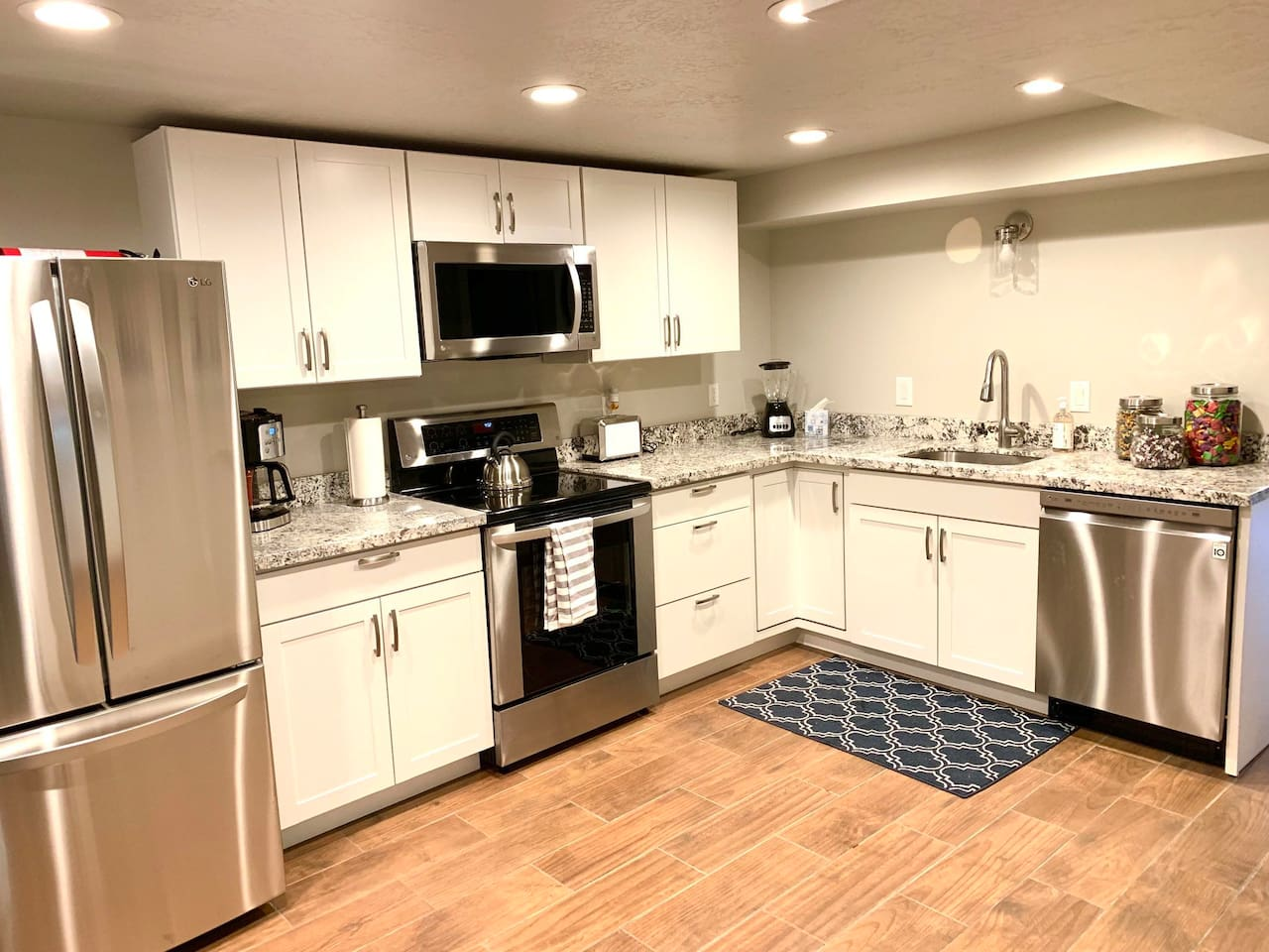 Kitchen with new LG appliances,  Granite countertops, and table for four. Complementary coffee, tea, and hot chocolate.