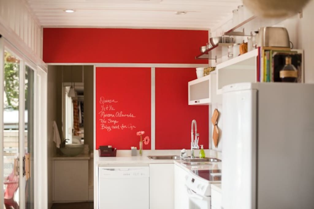 The Red chalkboard wall, the kitchen, and the bath