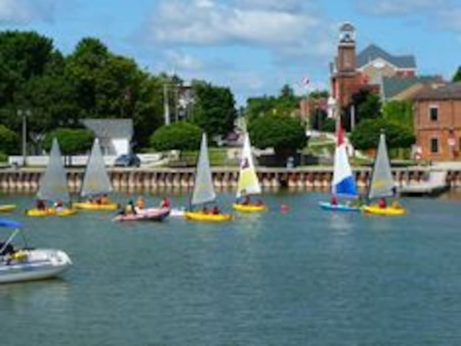 This is the sailing school outside the Harbour Cottage. You can see the white picket fence.