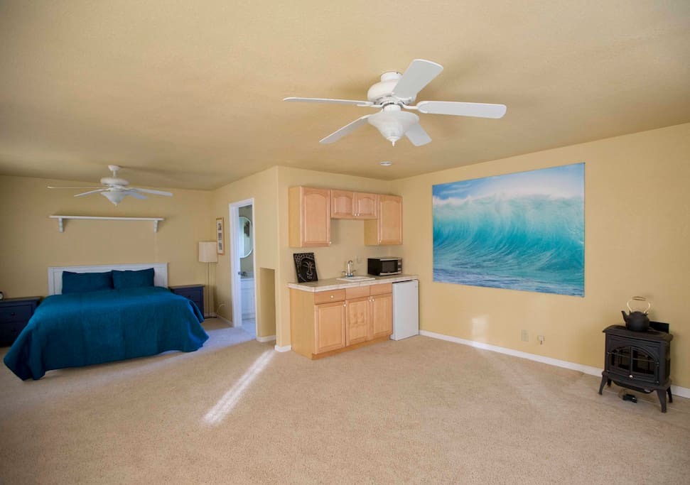 The Aloha cottage is decorated with a Hawaiian themed setting including photography wave prints taken on Kauai, driftwood decorations, and beautiful blue hues throughout the decor.