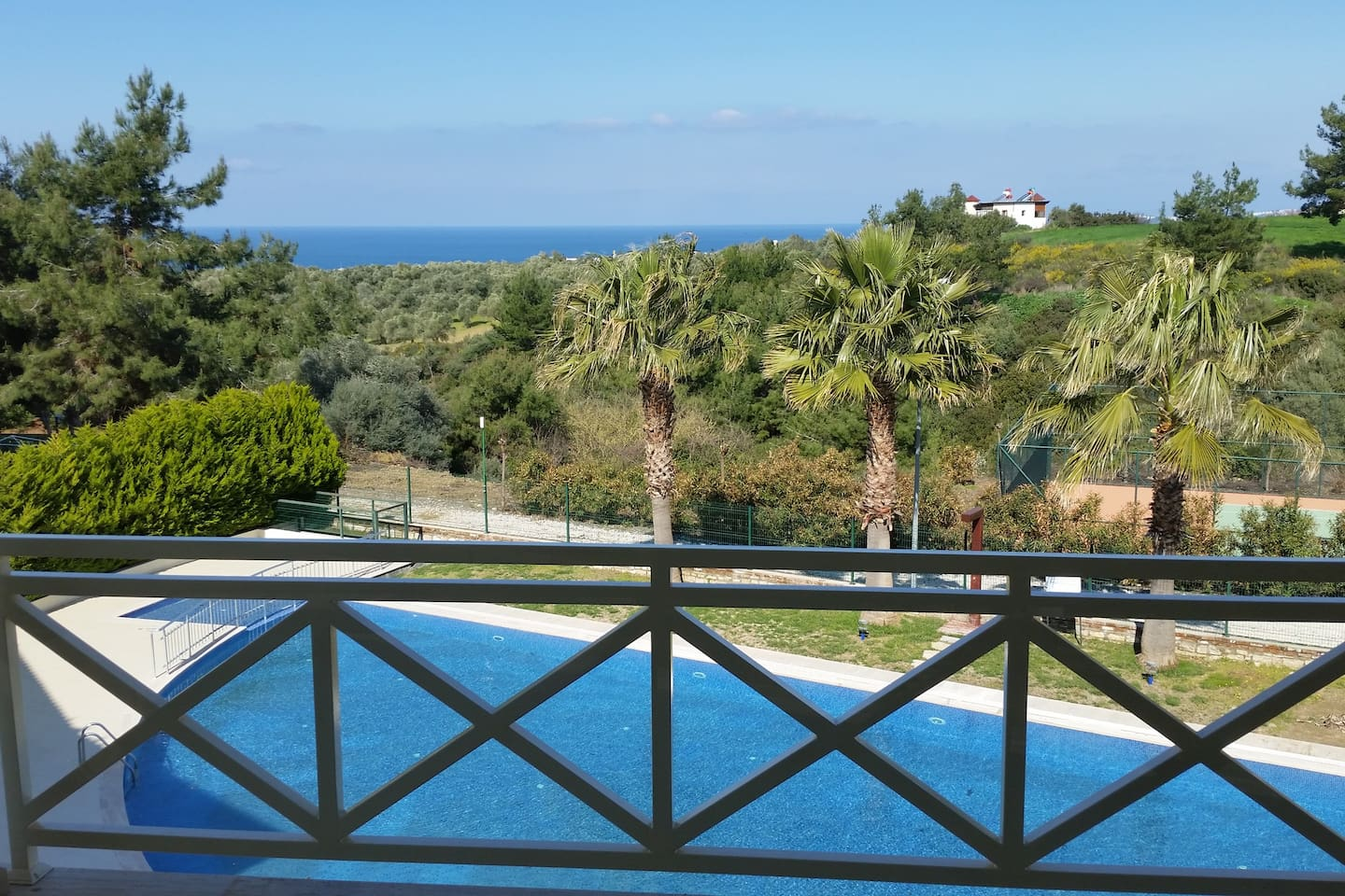 frontal view from all 4 private terraces - private tenniscourt