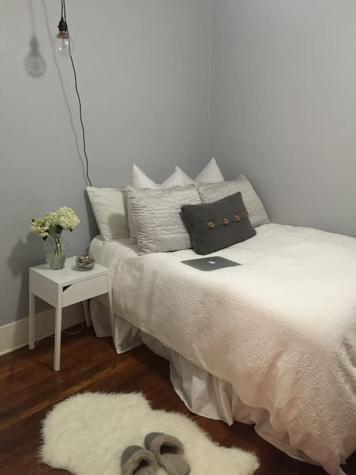 Cozy bedroom with memory foam double bed and pillows and down comforter.