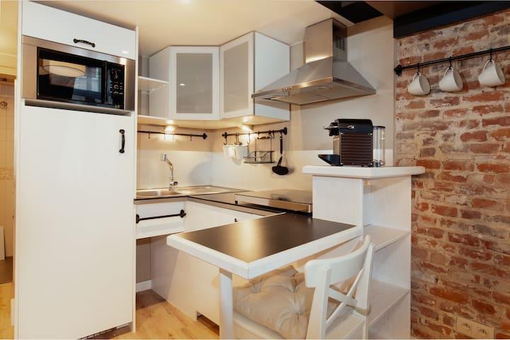 Kitchen with a Nespresso machine.