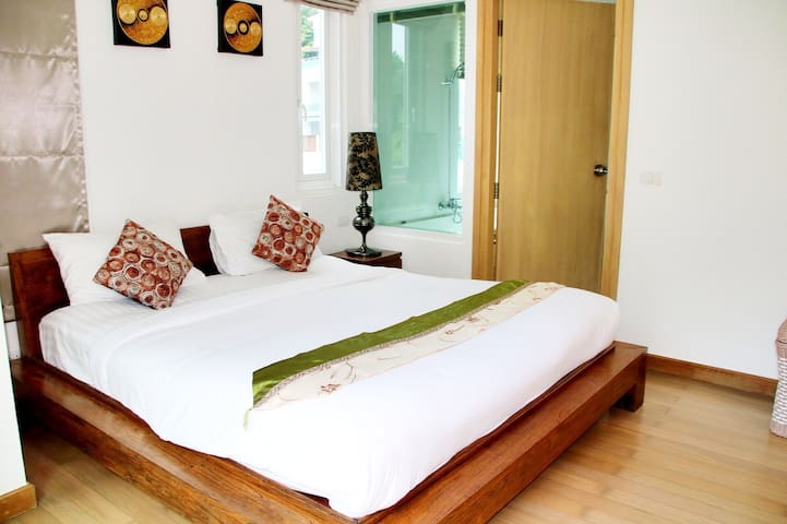 Master room with double bed and attached bathroom