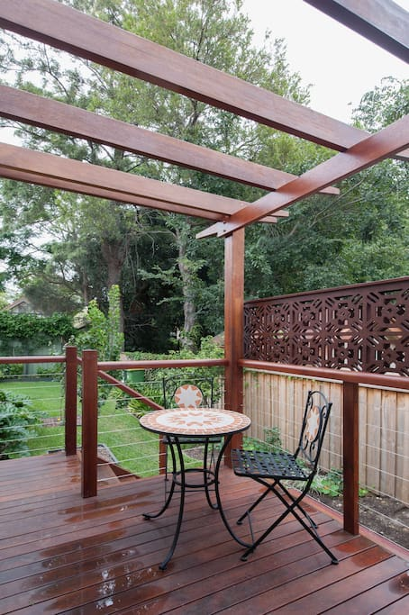 Secluded private deck for sole use of our guests. Enjoy a lazy breakfast in the morning sun or a glass of wine after a long day sightseeing or visiting.