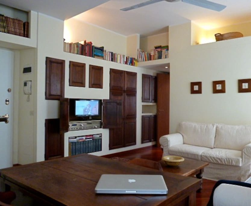 The living room with TV inside the wall unit