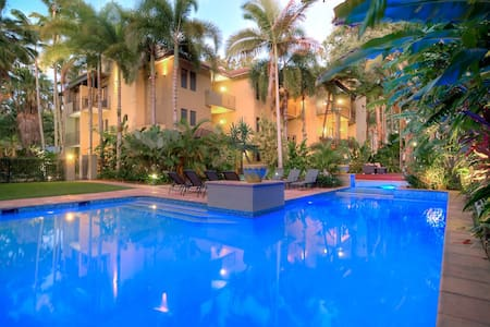 Relax and enjoy my airy, self-contained, two bedroom Reef Club apartment in Port Douglas.   Stroll up the beach to cafes, shops and entertainment, or relax by the pool and enjoy a BBQ  in the evening.  A great base to explore Tropical Queensland