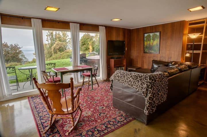 Flat screen TV, floor-to-ceiling windows and drapes