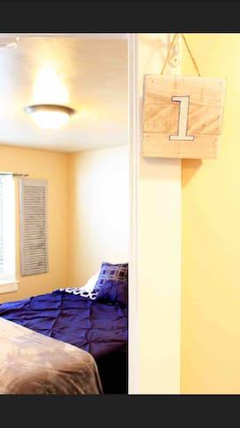 Room 1 has one queen bed.