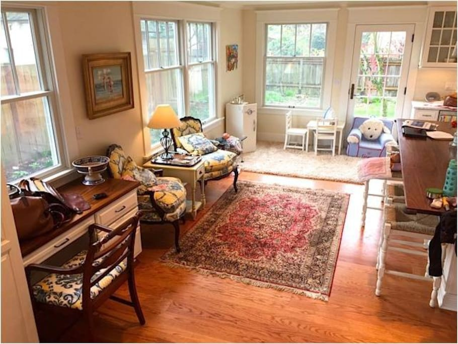 Sunlit kitchen with reading area, desk and chef's kitchen