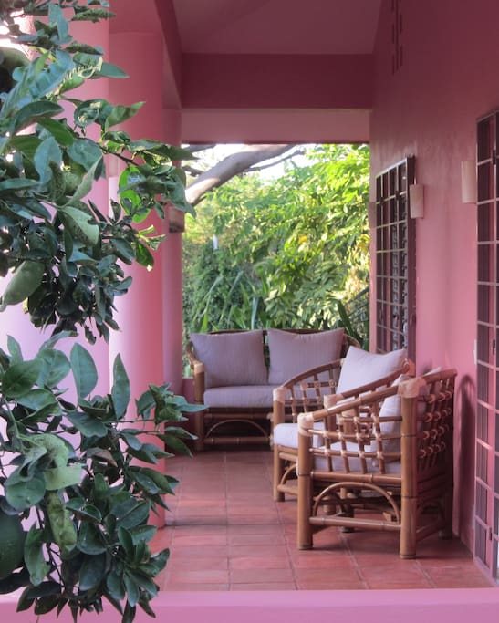 the casita porch is shady and pleasant, with comfortable seating