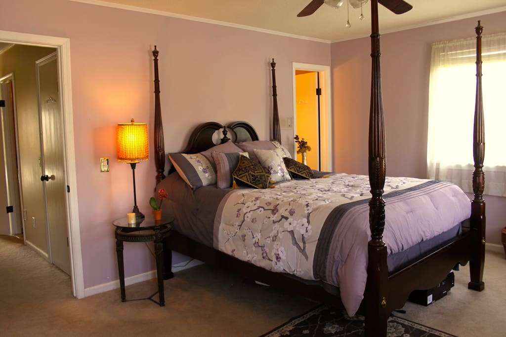 Master bedroom with queen bed and connecting bathroom