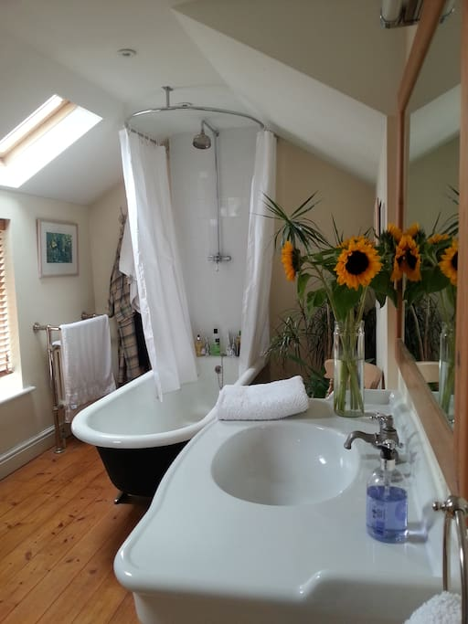 Beautiful bathroom with huge roll top bath - a relaxing soak gazing at the stars.