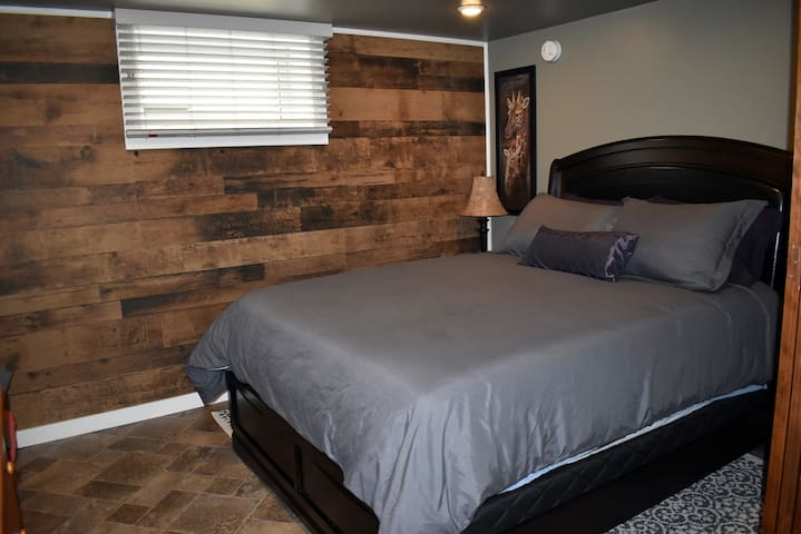 """Sliding panel walls in """"Tyler's"""" room will give you additional privacy in your suite. (Bedroom # 2)"""