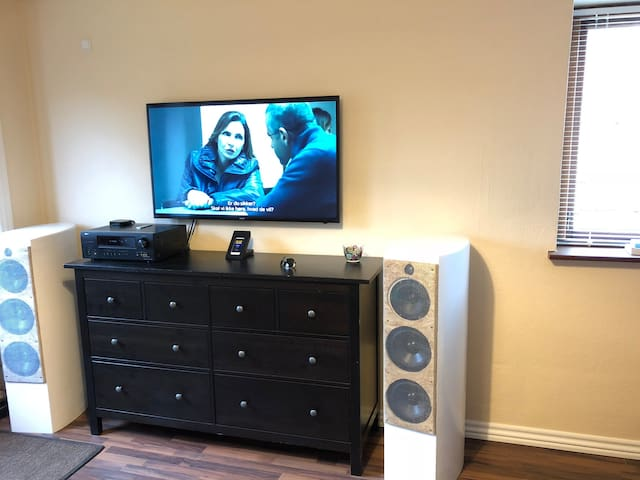 Large LED smart TV, a Denon amplifier and two large custom loud speakers for optimum sound experience. A unit for playing Spotify, YouTube music.   There is fully paid for, Spotify, Netflix, HBO for your use.