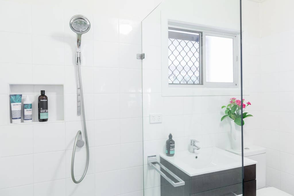 Bathroom with shampoo, conditioner, and soaps