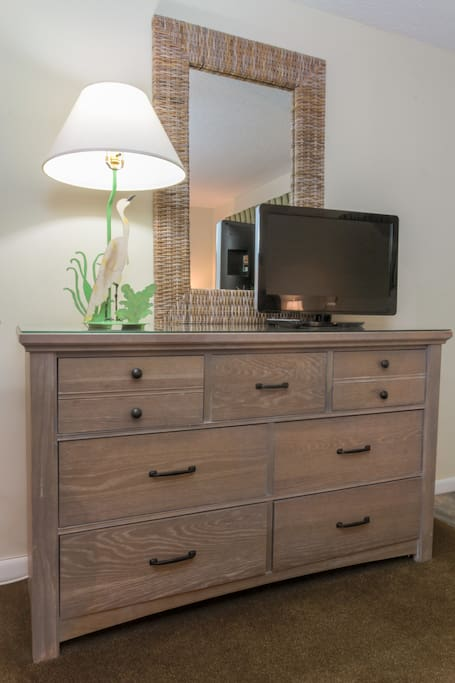 TV and dresser across from bed