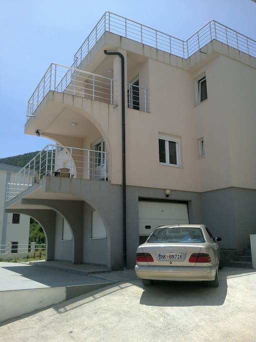 The villa has a private garage and an extra parking space outside