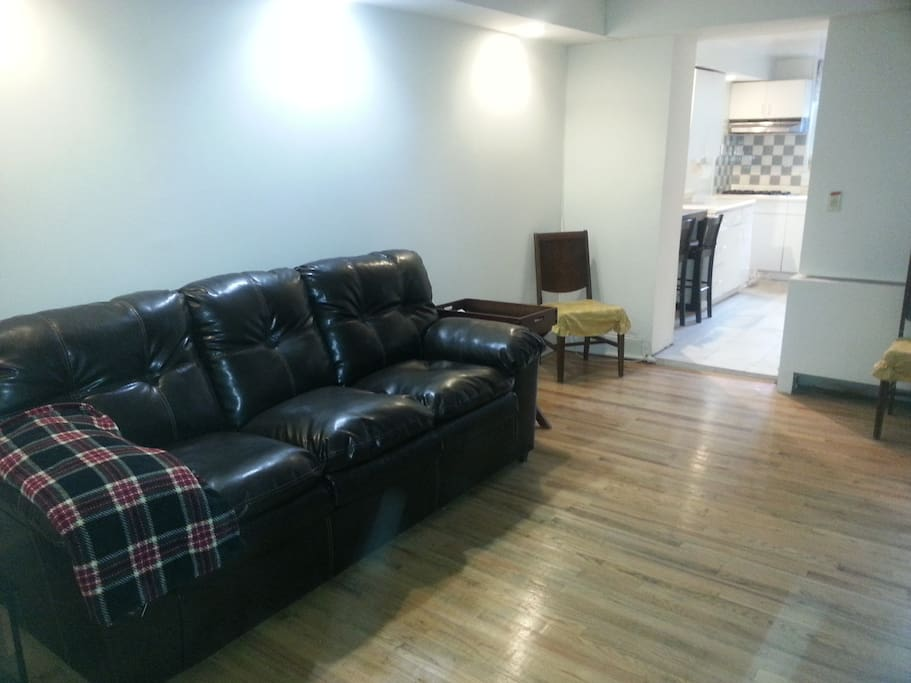 Main room has queen size bed and large leather couch converts to a bed as well.