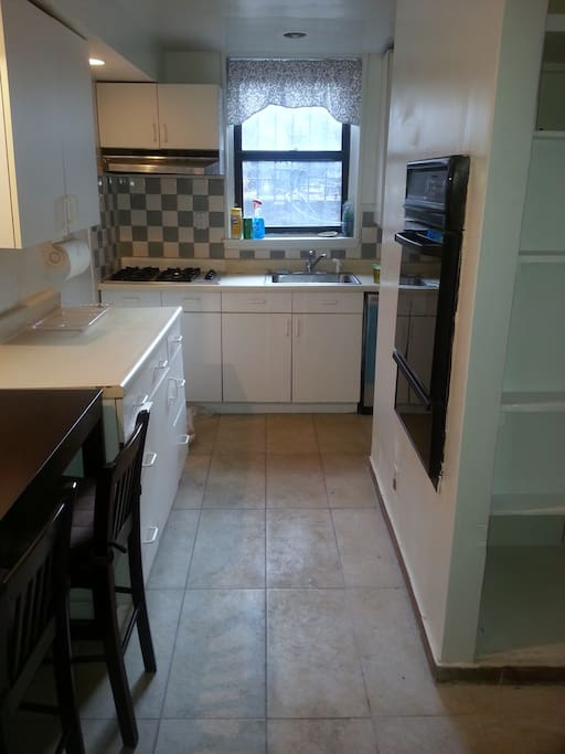 Eat In Kitchen has view of garden and also a door leading directly out to the yard.