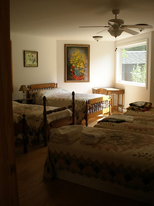 East bedroom, 2 full size beds, 4 twin beds.