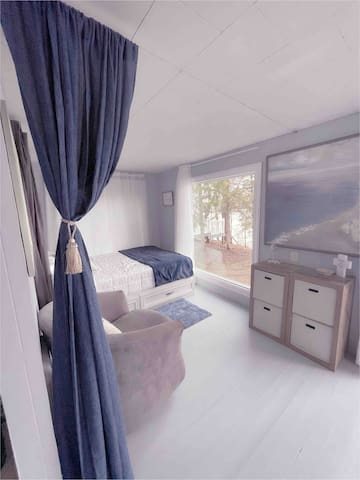 Wake up to beautiful water views. Privacy curtain (partial) separates bed and reading nook from common areas.