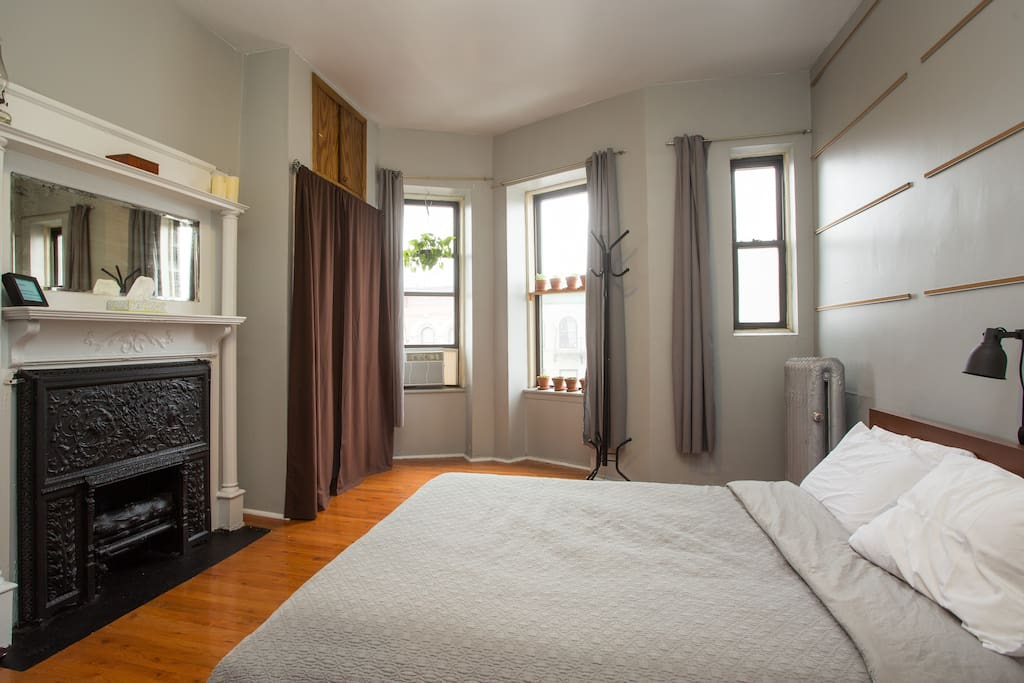 The guest suite bedroom. Great sunlight, hardwood floors, and dangerously comfortable queen bed.