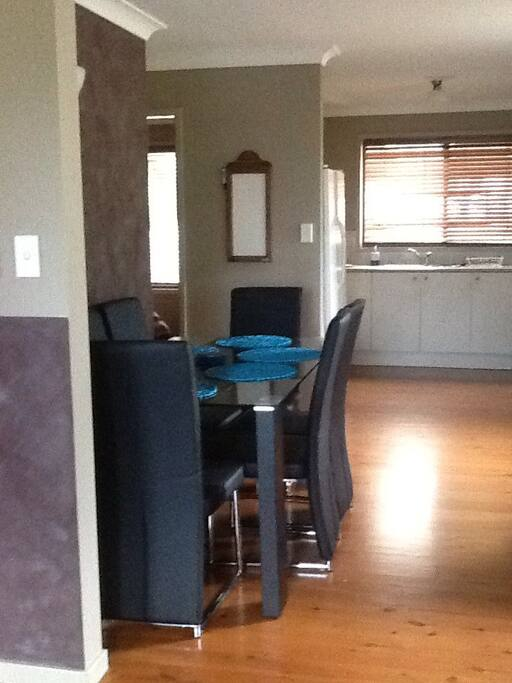 Dining room with 6 seater dining room table, there is also a Brekky bench that seats two.