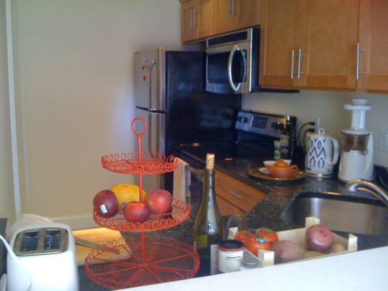 Kitchen, remodeled last year with stainless steel appliances including dish washer, and marble counters