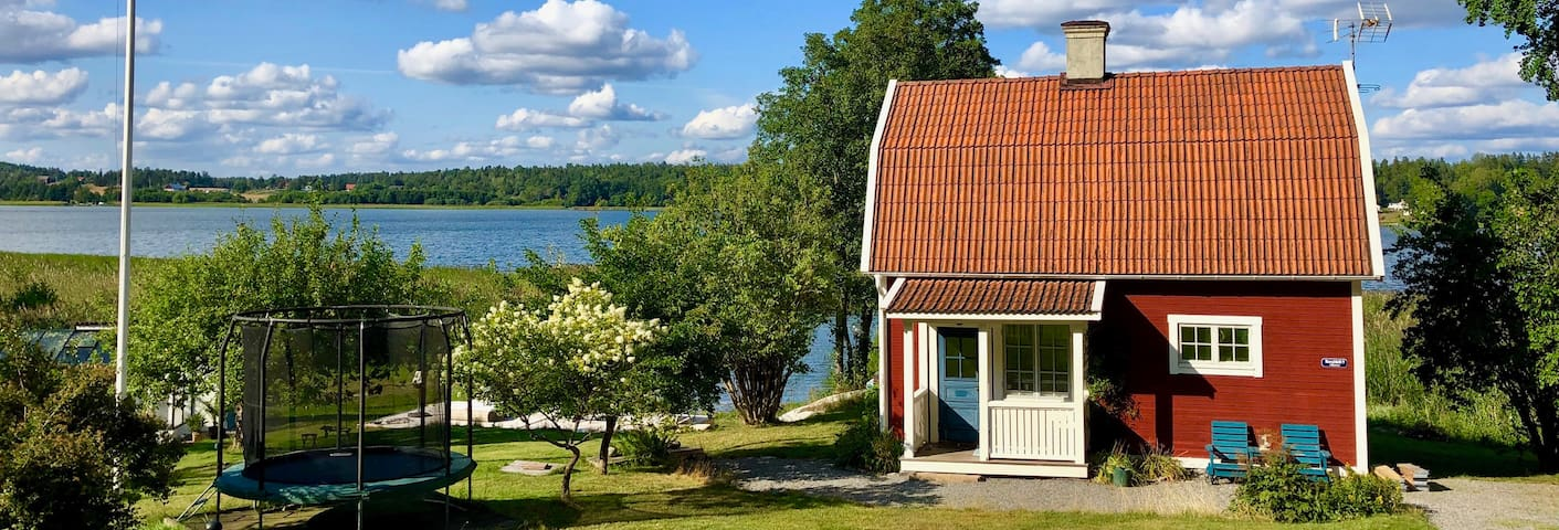 Romantic traditional Swedish house by the water