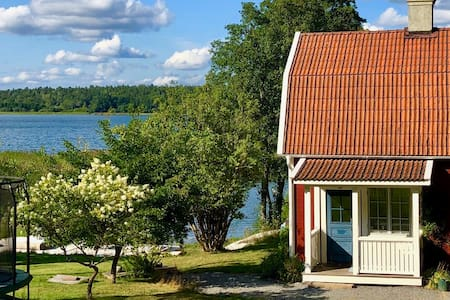 Romantic traditional Swedish house by the lake