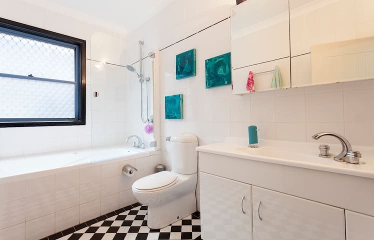 Bathroom with large bath and shower