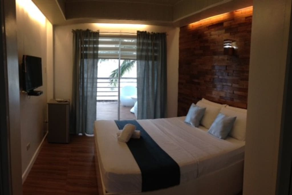 "60"" w/ pullout sleeps max3. - PHP 2500/night. 500/extra person."