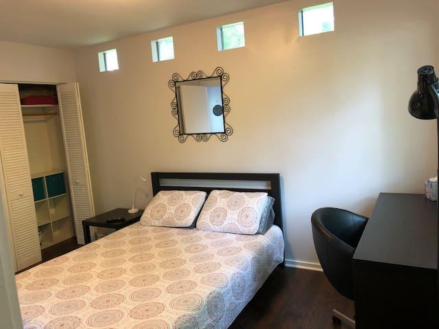 Bedroom: queen bed with memory foam mattress, work space, plenty of closet space.