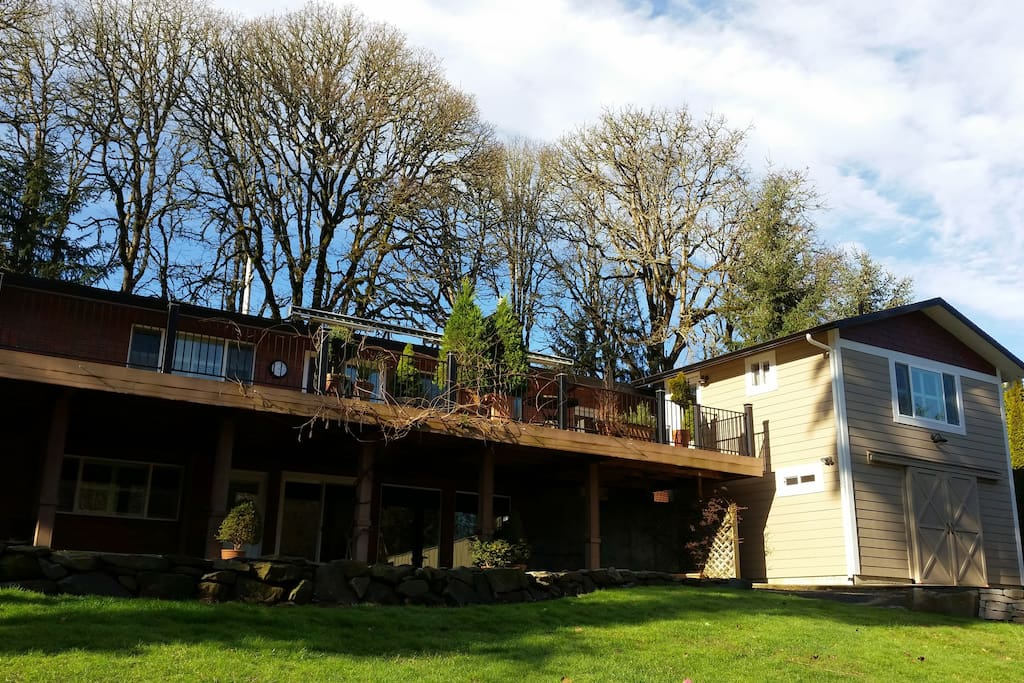 External view of the deck, terrace and Guest House (on right, above the Workshop).