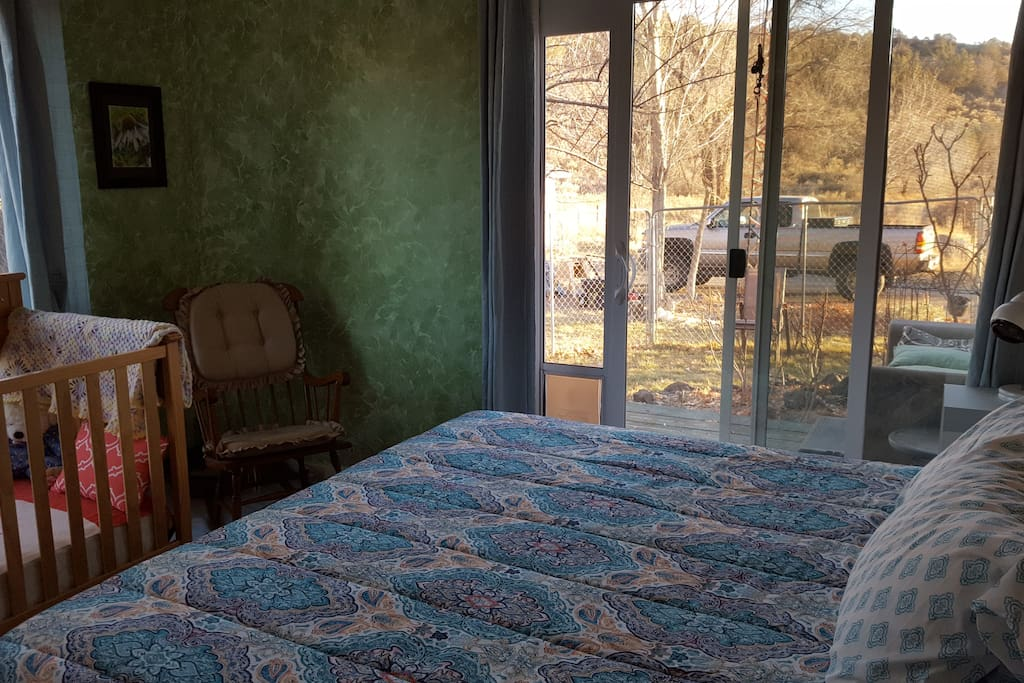 Guest room with our without crib or toddler bed has a private deck.