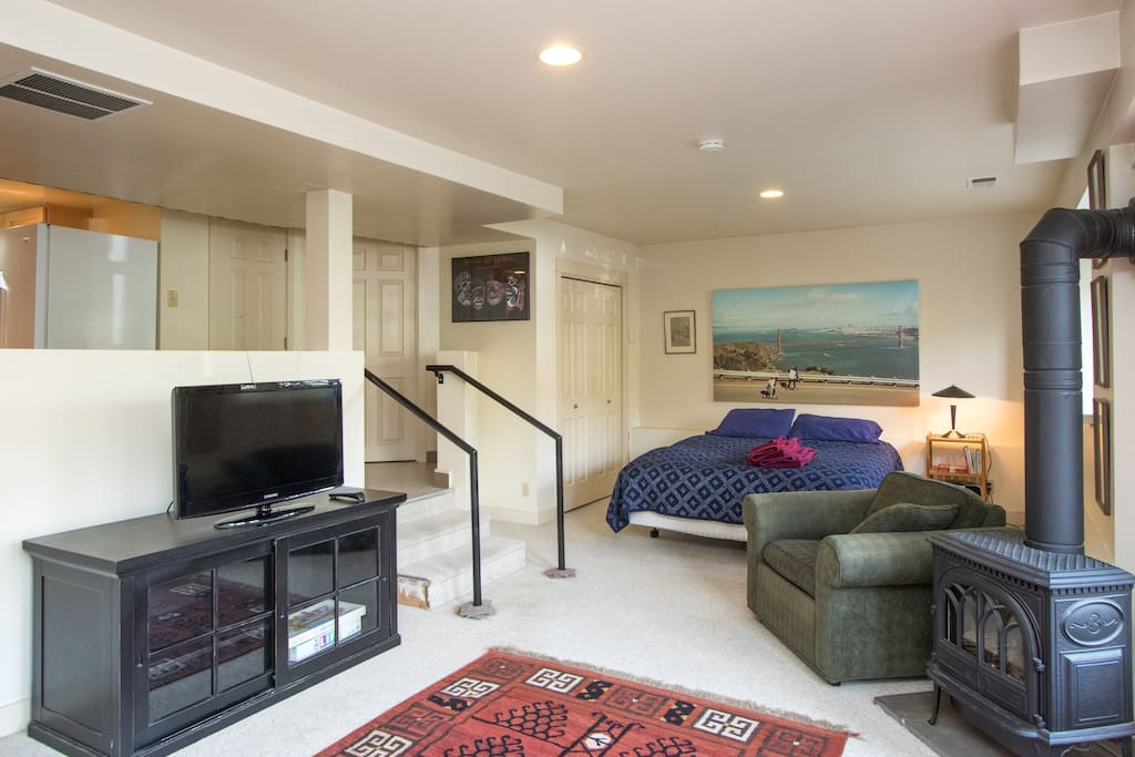Daylight basement, queen bed, tv