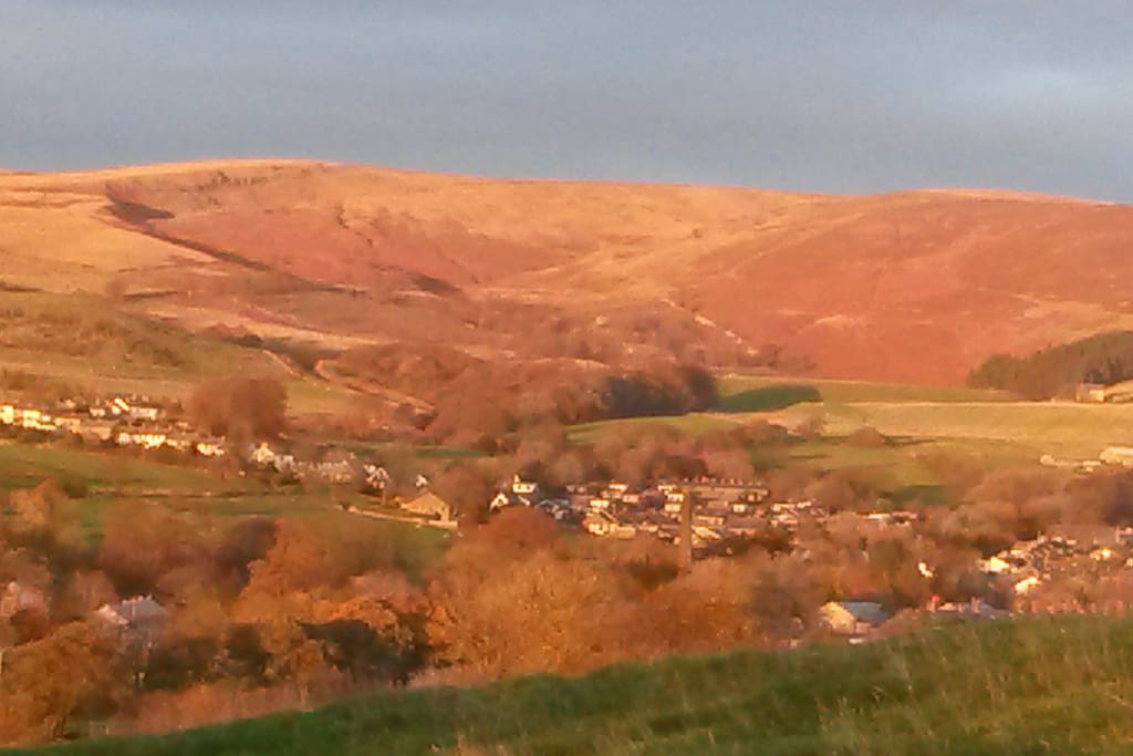 Sabden village and Pendle Hill in the sunset from Cobden View