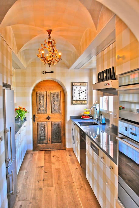 Fully stocked gourmet kitchen features beautiful local granite countertops and all new appliances
