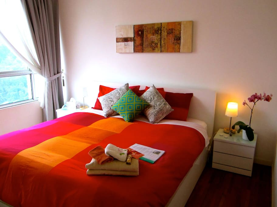 Bedroom 1- Comfy king bed with ensuite bathroom & ceiling fan/air conditioning