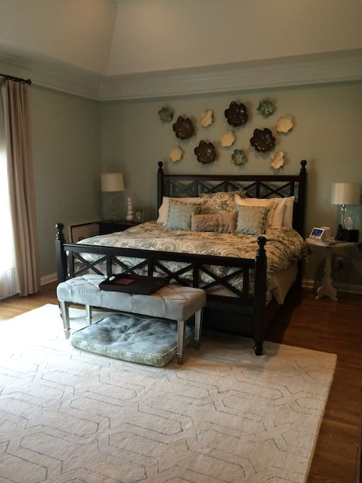 Spacious master suite with 3 large windows over looking back yard