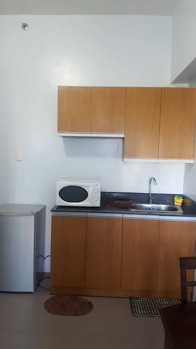 The kitchen contains the microwave, electric stove and refrigeritor. These are all allowed to use.