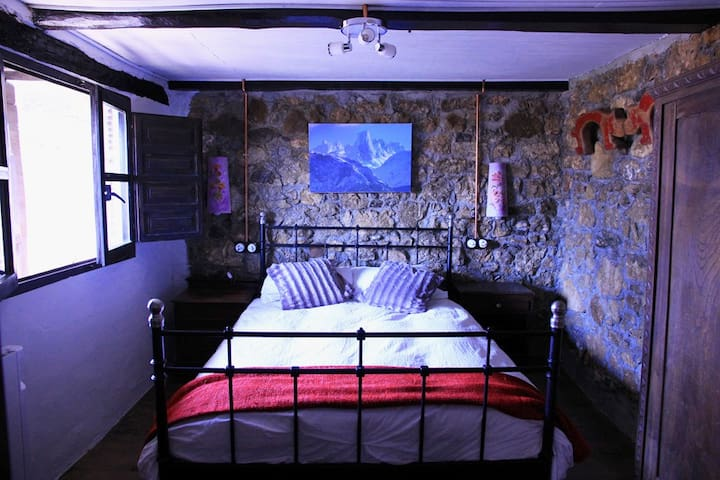 The comfortable double bedroom has stunning mountain views