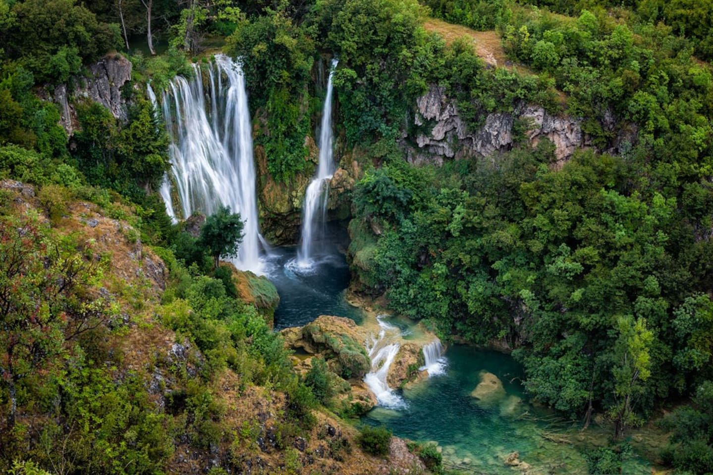 Northern part of National park Krka, longest waterfall, Manojlovac Waterfall, 10-15 mins drive, one can walk down by the waterfall, have picnic and rest all day long in a richness of nature and sounds