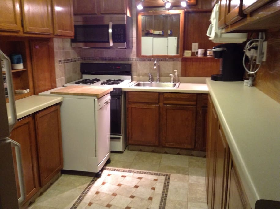 Private kitchen stocked with silverware, dishes, and appliances for you to use during your stay!