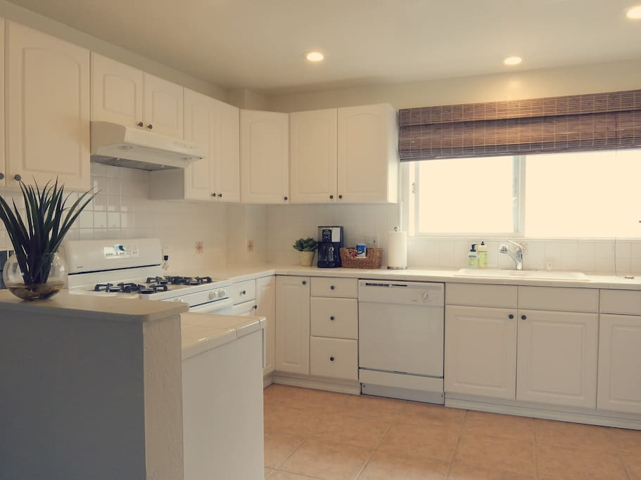 Full kitchen with plenty of room, all major appliances, and all cooking and dining essentials